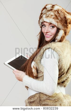 Woman In Winter Clothing With Tablet