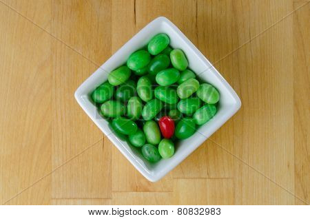 Red Jelly Bean In A Pile Of Green Jelly Beans