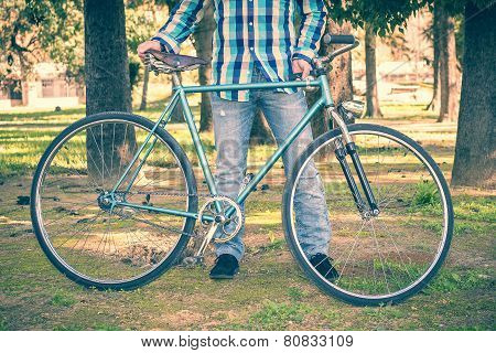 Man With Old Bike And Plaid Shirt