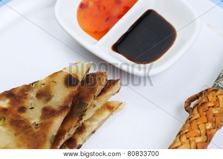 Scallion pancakes arrayed on plate