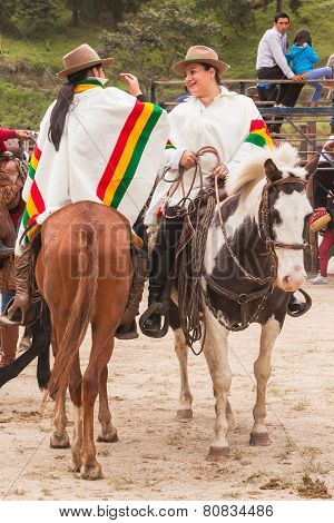 Young Latin Cowboy Womans Riding Horses