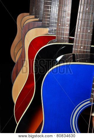 Acoustic Guitars Isolated On Black Background