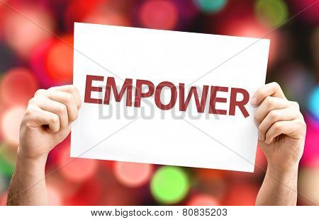 Empower card with colorful background with defocused lights