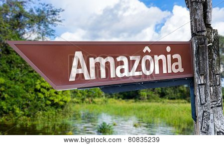 Amazonia wooden sign with a forest background