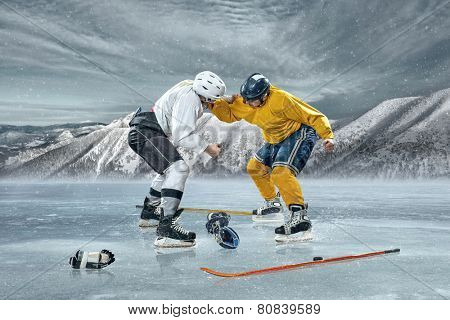 Ice hockey players in box action on the ice