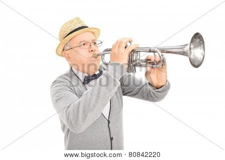Senior gentleman playing a trumpet isolated on white background