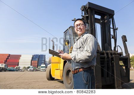 Happy Stacker Driver Writing On A Document