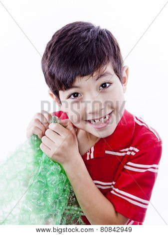 Boy Enjoying Bubble Wrap.