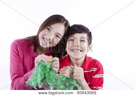 Siblings Popping Bubble Wrap.