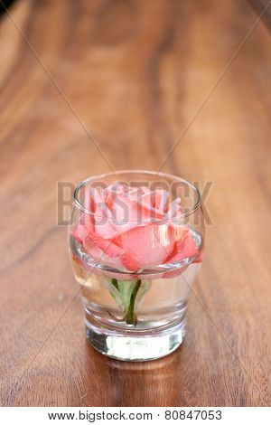 Rose In A Glass Decorate On The Table.