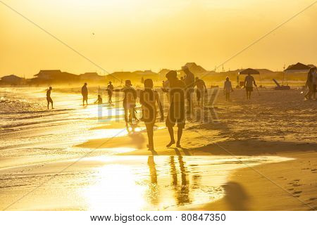 People Enjoy The Beautiful Beach In Late Afternoon  At Dauphin Islands