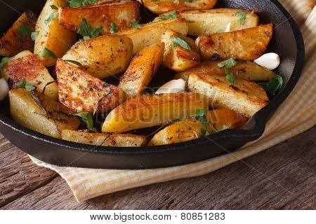 Baked Potatoes In A Frying Pan Close-up Horizontal