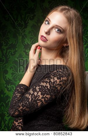 Sexy Woman In Black Dress On Green Background