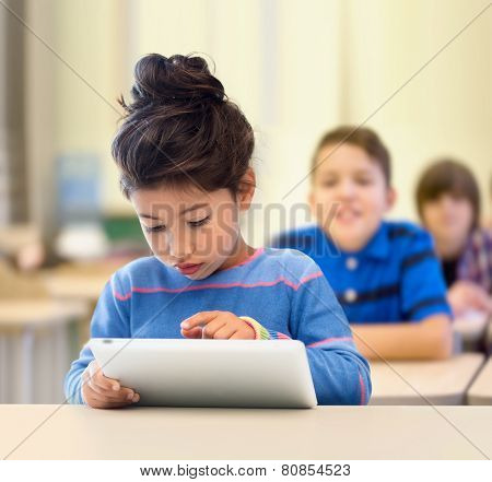 education, elementary school, technology and children concept - little student girl with tablet pc over classroom and classmates background
