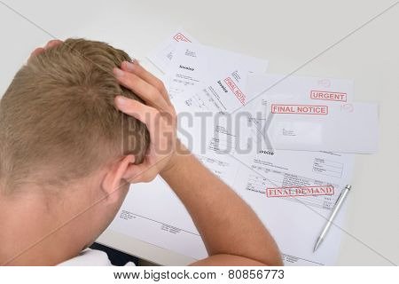 Frustrated Man With Unpaid Bills