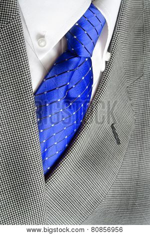 White dress shirt with blue tie and suit jacketdetailed closeup