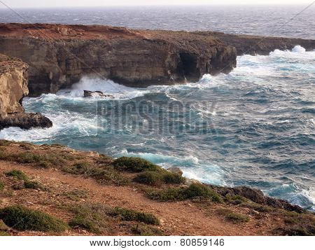 Very High Cliff On The Sea With Waves