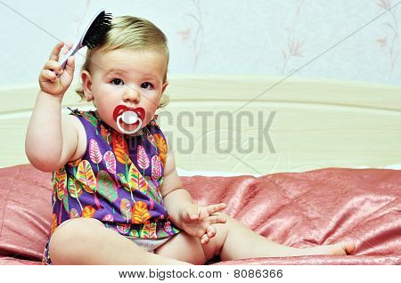 Baby Girl Using Comb