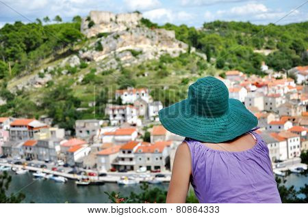 Woman With Hat Admiring Cityscape