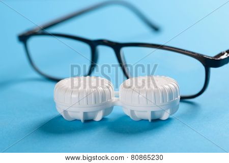 Eyeglasses And Lens Case On Blue Background