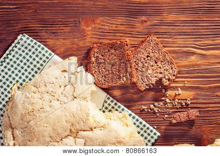 White And Wholemeal Bread On Wooden Table