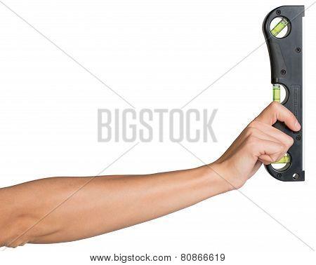 Female hand holding builder's level