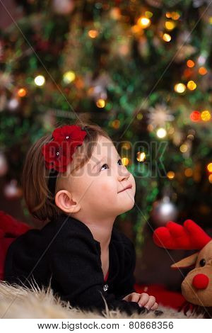 Baby Girl Under Christmas Tree