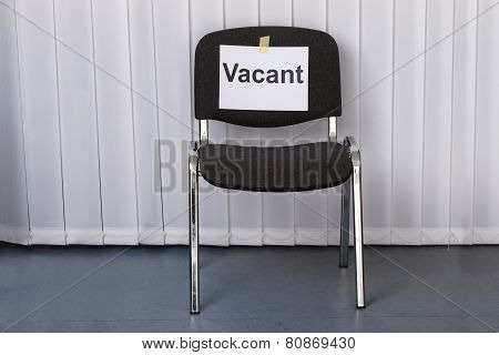 Office Chair With A Vacant Sign
