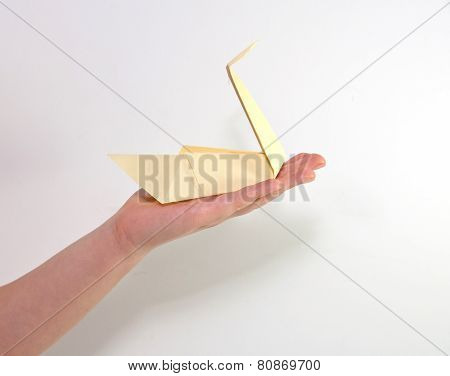 Child`s Hand With Yellow Swan