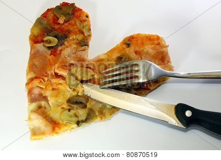 Slice Of Pizza In The Shape Of A Heart With A Knife