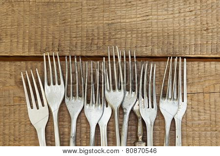 Background With  Retro Forks On Wooden Table