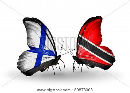 Two Butterflies With Flags On Wings As Symbol Of Relations Finland And Trinidad And Tobago