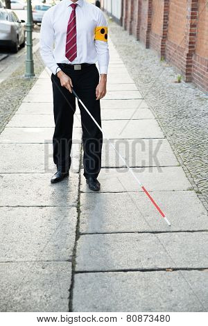 Blind Man Walking On Sidewalk