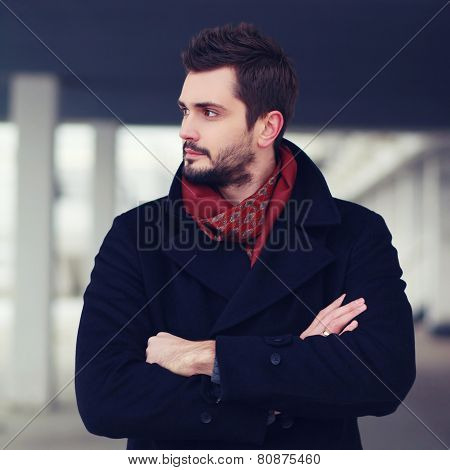 Portrait Handsome Successful Man Stands With Crossed Hands And Confident Looking Away