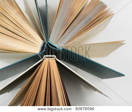 Group of books on white background, top view