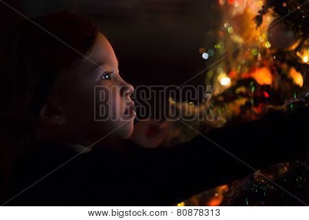 Baby Girl By Christmas Tree At Night