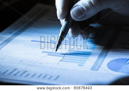 Businessperson Analyzing Graph