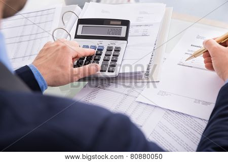 Businessman Doing Calculating