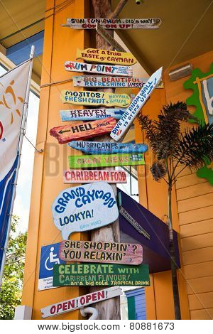 GEORGETOWN, GRAND CAYMAN - MARCH 25, 2009:  Grand Cayman is a popular travel destination in the Caribbean and this is a sign in the heart of the tourist district.