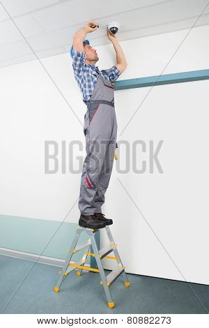 Technician Fixing Cctv Camera