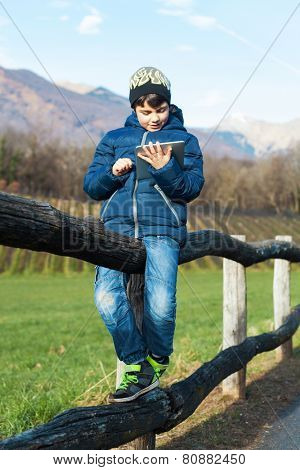 child play with her tablet in outdoor