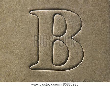 die cut alphabet b on the brown card board