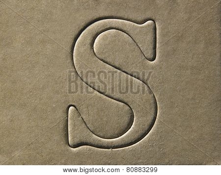 die cut alphabet s on the brown card board