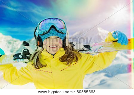 Ski vacation, snow, skier, sun and fun - girl enjoying winter vacations, filtered