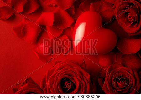 Valentine red heart on red silk background. Valentine's Day