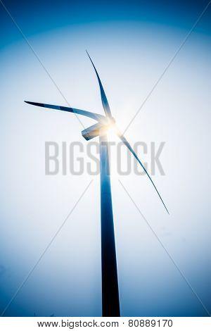 wind generators aganist the blue sky, blue toned.