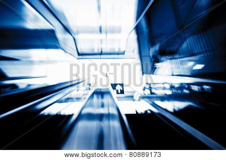 motion escalator at airport  concept of business background, blue toned images.