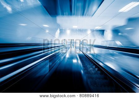 motion escalator at airport, concept of business background, blue toned images.
