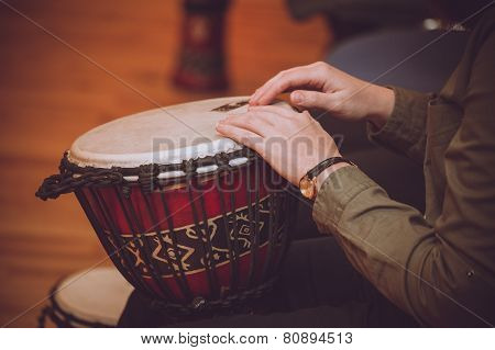 Person Playing On Jambe Drum