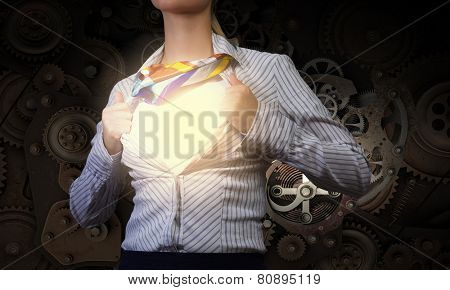 Young woman tearing shirt on chest. Mechanism concept